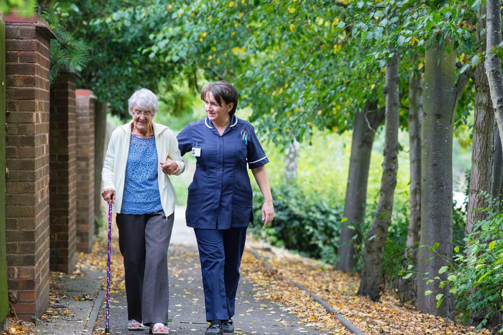 Caretaker walking with senior citizen